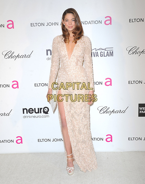 Analeigh Tipton.The 21st Annual Elton John AIDS Foundation Academy Awards Viewing Party held at The City of West Hollywood Park in West Hollywood, California, USA..February 24th, 2013.oscars full length white lace dress slit split clutch bag                                                                          .CAP/DVS.©DVS/Capital Pictures.