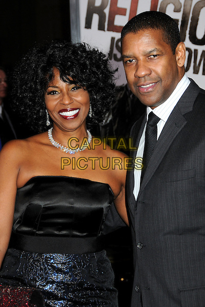 "PAULETTA & DENZEL WASHINGTON at Alcon Entertainment's L.A. Premiere of ""The Book of Eli"" held at The Chinese Theatre in Hollywood, California, USA, January 11th 2010. .half length black and blue shiny dress grey gray suit tie married couple husband wife pattern patterned necklace diamond earrings smiling .CAP/ADM/BP.©Byron Purvis/AdMedia/Capital Pictures."