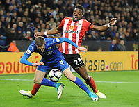 Jamie Vardy of Leicester City and Lamine Koné of Sunderland during the Premier League match between Leicester City v Sunderland played at King Power Stadium, Leicester on 4th April 2017.<br /> <br /> <br /> available via IPS Photo Agency/Rex Features  only