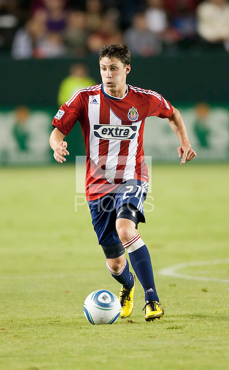 Chivas midfielder Ben Zemanski (21) move the ball up the field during the second half of the game between Chivas USA and the New England Revolution at the Home Depot Center in Carson, CA, on September 10, 2010. Chivas USA 2, New England Revolution 0.