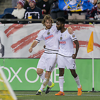 Foxborough, Massachusetts - September 26, 2015: In a Major League Soccer (MLS) match, the New England Revolution (blue/white) tied Philadelphia Union (white), 1-1, at Gillette Stadium.<br /> Fernando Aristeguieta celebrates his goal with teammate.