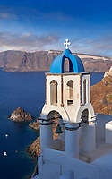 Bell tower of traditional blue domed Greek Orthodox church of Oia, Thira Island, Santorini Greece.