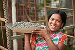 Helping to rebuild her house damaged in August 2017 flooding, Sefali carries mortar in Suihari in northern Bangladesh. (The woman uses just one name.) The water damaged homes and swept away animals and crops across the region. Christian Aid and the Christian Commission for Development Bangladesh, both members of the ACT Alliance, worked together to provide emergency food packages to vulnerable families in the affected area.
