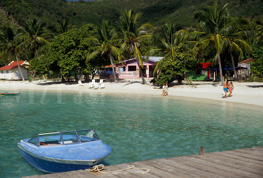 AJ2371, resort, British Virgin Islands, Jost Van Dyke, Caribbean, Virgin Islands, BVI, B.V.I., Scenic coastline and boat moored on dock of Great Harbor on the island of Jost Van Dyke on the British Virgin Islands.
