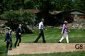 (L-R) Canadian Prime Minister Stephen Harper, French President Francois Hollande, U.S. President Barack Obama and German Chancellor Angela Merkel arrive for a group photo during the 2012 G8 Summit at Camp David May 19, 2012 in Camp David, Maryland. Leaders of eight of the worlds largest economies meet over the weekend in an effort to keep the lingering European debt crisis from spinning out of control. .Credit: Luke Sharrett / The New York Times / Pool via CNP