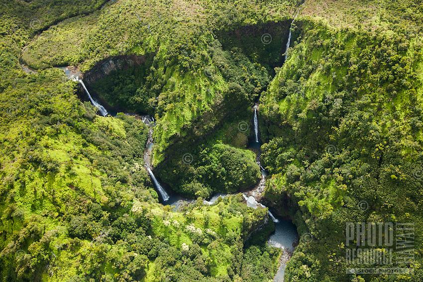 An aerial perspective of beautiful waterfalls on Kaua'i.