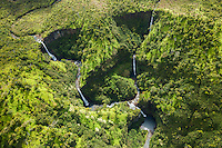 An aerial perspective of beautiful waterfalls on Kaua'i.