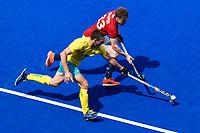 2nd February 2020; Sydney Olympic Park, Sydney, New South Wales, Australia; International FIH Field Hockey, Australia versus Great Britain; Jacob Draper of Great Britain is tackled by Kurt Lovett of Australia