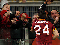 Calcio, Serie A: Roma vs Torino. Roma, stadio Olimpico, 25 marzo 2014.<br /> AS Roma midfielder Alessandro Florenzi kisses his jersey to celebrate after scoring the winning goal in the last minutes of the Italian Serie A football match between AS Roma and Torino at Rome's Olympic stadium, 25 March 2014. AS Roma won 2-1.<br /> UPDATE IMAGES PRESS/Riccardo De Luca