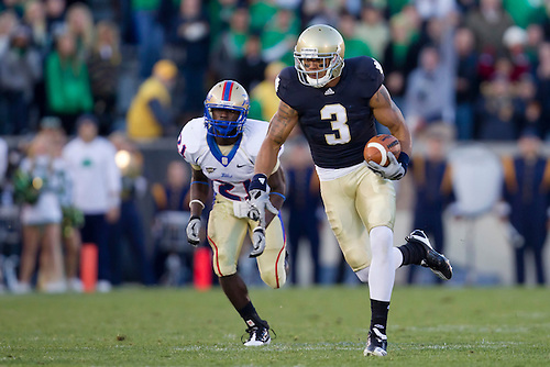 Notre Dame wide receiver Michael Floyd (#3) runs for yardage after catch during NCAA football game between Tulsa and Notre Dame.  The Tulsa Golden Hurricane defeated the Notre Dame Fighting Irish 28-27 in game at Notre Dame Stadium in South Bend, Indiana.