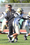 Torrance, CA 10/06/11 - Coach Esparza and Brendon Frank (Peninsula #32) in action during the Peninsula vs South Torrance Frosh football game.