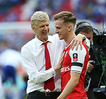 Arsene Wenger manager of Arsenal congratulates Rob Holding of Arsenal during the Emirates FA Cup Final match at Wembley Stadium, London. Picture date: May 27th, 2017.Picture credit should read: David Klein/Sportimage