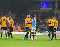 27th December 2019; Molineux Stadium, Wolverhampton, West Midlands, England; English Premier League, Wolverhampton Wanderers versus Manchester City; Matt Doherty of Wolverhampton Wanderers shaking hands with Raheem Sterling of Manchester City after the final whistle - Strictly Editorial Use Only. No use with unauthorized audio, video, data, fixture lists, club/league logos or 'live' services. Online in-match use limited to 120 images, no video emulation. No use in betting, games or single club/league/player publications