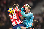 Goalkeeper Norberto Murara Neto of Valencia CF (R) reaches for the ball after an attempt at goal by Atletico de Madrid during the La Liga 2017-18 match between Atletico de Madrid and Valencia CF at Wanda Metropolitano on February 04 2018 in Madrid, Spain. Photo by Diego Souto / Power Sport Images