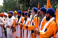 """Rome April 30 2006  .Piazza Vittorio  .Sikh """"Punj Pyare"""" (Five Beloved Ones) lead a religious parade.The parade is for Visaki, a traditional Sikh celebration.."""