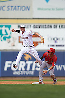 Erie Seawolves shortstop JaCoby Jones (12) throws to first over Reegie Corona (6) during a game against the Harrisburg Senators on August 30, 2015 at Jerry Uht Park in Erie, Pennsylvania.  Harrisburg defeated Erie 4-3.  (Mike Janes/Four Seam Images)