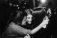 """Switzerland. Canton Ticino. Oggio. Grotthard Café. Micaela Ruef (L), Camille de Righetti (C) and Paola Ranghino (R) celebrate their Matura with joy and emotion. They gently hug together and let themselves be happy. Matura or its translated terms (Mature, Matur, Maturita, Maturità, Maturität, Mатура) is a Latin name for the high-school exit exam or """"maturity diploma"""". It is taken by young adults (usually aged from 17 to 20) at the end of their secondary education, and generally must be passed in order to apply to a university or other institutions of higher education. Matura is a matriculation examination and can be compared to A-Level exams or Abitur. A hug is a form of physical intimacy, universal in human communities, in which two people put their arms around the neck, back, or waist of one another and hold each other closely. If more than two persons are involved, this is informally referred to as a group hug. 28.06.15 © 2015 Didier Ruef"""