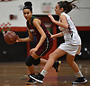 Trinity Hudson #3 of Glen Cove, left, gets pressured by Emily Tierney #5 of Plainedge during a Nassau AA-3 girls basketball game at Plainedge High School on Thursday, Dec. 20, 2018.