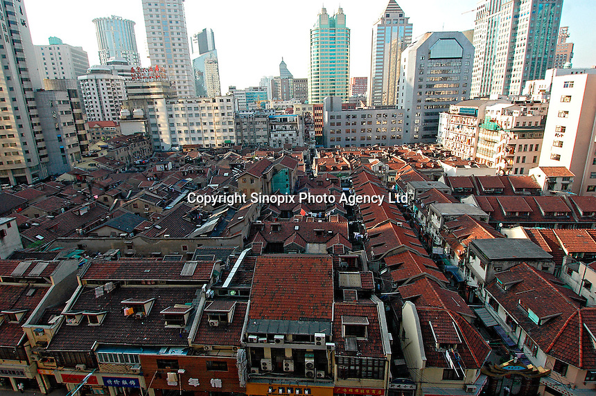 An island of old-style housing still survives near Nanjing Road in downtown Shanghai. Such developments are becoming increasingly rare as traditional housing is demolished to make way for new developments.   .14 May 2006