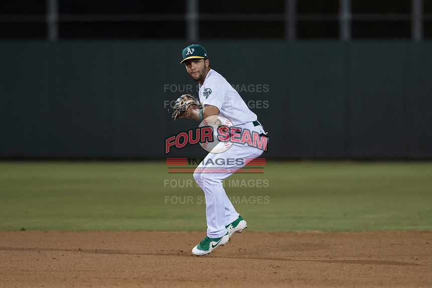 AZL Athletics shortstop Yerdel Vargas (2) prepares to make a throw to first base during an Arizona League game against the AZL Giants Orange at Lew Wolff Training Complex on June 25, 2018 in Mesa, Arizona. AZL Giants Orange defeated the AZL Athletics 7-5. (Zachary Lucy/Four Seam Images)