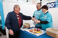 John Flint from Nottingham gets a tape measure from John Church and Dina of Diabetes UK