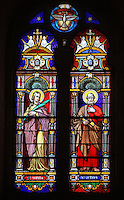 Stained glass window of St Sophia and St Peter by Julien Leopold Lobin, 1814-64, installed 1855, in the Royal Chapel, on the second floor of the Phare de Cordouan or Cordouan Lighthouse, built 1584-1611 in Renaissance style by Louis de Foix, 1530-1604, French architect, located 7km at sea, near the mouth of the Gironde estuary, Aquitaine, France. This is the oldest lighthouse in France. There are 4 storeys, with keeper apartments and an entrance hall, King's apartments, chapel, secondary lantern and the lantern at the top at 68m. Parabolic lamps and lenses were added in the 18th and 19th centuries. The lighthouse is listed as a historic monument. Picture by Manuel Cohen