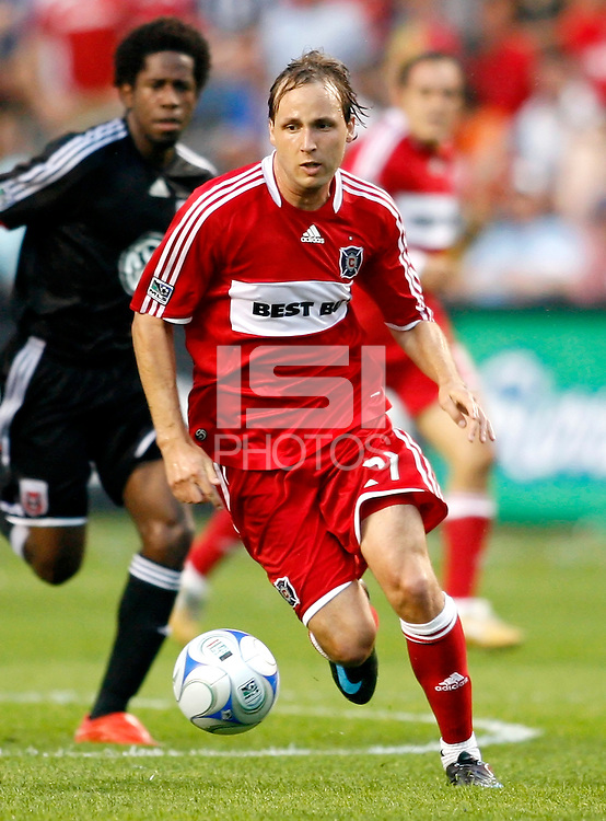 Chicago Fire midfielder Justin Mapp (21) advances toward the DC United goal as DC United midfielder Clyde Simms (19) looks on.  The DC United defeated the Chicago Fire 2-1 at Toyota Park in Bridgeview, IL on June 7, 2008.