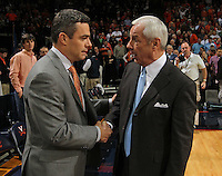 Virginia Cavaliers head coach Tony Bennett, left, shakes hands with North Carolina Tar Heels head coach Roy Williams during the game against Virginia in Charlottesville, Va. North Carolina defeated Virginia 54-51.