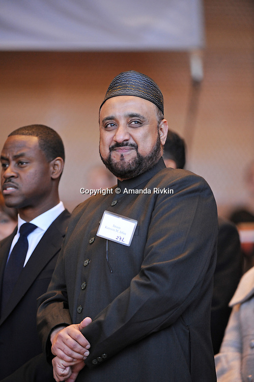 Imam Kareem Irfan, the President of the Council of Religious Leaders of Metropolitan Chicago, enters the stage at the inauguration ceremony of Chicago Mayor Elect Rahm Emanuel and other public officials in Millennium Park in Chicago, Illinois on May 16, 2011.