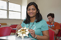 OrigamiUSA 2016 Convention at St. John's University, Queens, New York, USA. Creasers in Sunil Dhavalikar's Dahlia class. First timer Nikki Chaudhari, New York, shows her completed model.