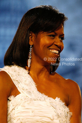 Washington, DC - January 20, 2009 -- United States First Lady Michelle Obama attends the Neighborhood Inaugural Ball at the Washington Convention Center on January 20, 2009 in Washington, DC. Obama became the first African-American to be elected to the office of President in the history of the United States.  .Credit: Chip Somodevilla - Pool via CNP