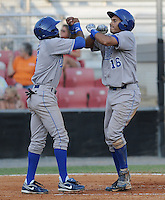 Infielder Michael Antonio (16) of the Burlington Royals is congratulated after hitting a home run in a game against the Kingsport Mets on August 20, 2011, at Hunter Wright Stadium in Kingsport, Tennessee. Kingsport defeated Burlington, 17-14. (Tom Priddy/Four Seam Images)