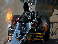 Feb 21, 2014; Chandler, AZ, USA; NHRA top fuel dragster driver Troy Buff has fire come from his engine during qualifying for the Carquest Auto Parts Nationals at Wild Horse Pass Motorsports Park. Mandatory Credit: Mark J. Rebilas-USA TODAY Sports
