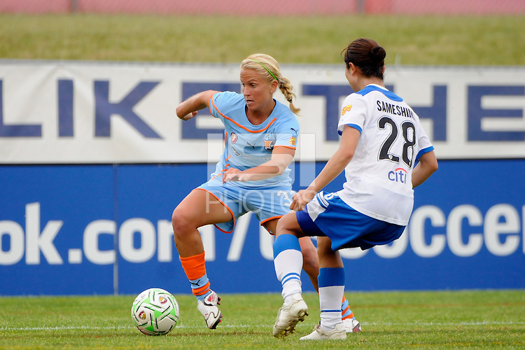 Alyssa Mautz (33) of Sky Blue FC is marked by Aya Sameshima (28) of the Boston Breakers. Sky Blue FC and the Boston Breakers played to a 0-0 tie during a Women's Professional Soccer (WPS) match at Yurcak Field in Piscataway, NJ, on June 12, 2011.
