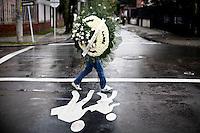 A man carries flowers in a street of Bogota, Colombia. 29/02/2012.  Photo by Eduardo Munoz Alvarez / VIEWpress.