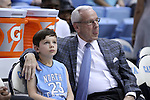 18 February 2017: UNC head coach Roy Williams (right) with his grandson Aiden. The University of North Carolina Tar Heels hosted the University of Virginia Cavaliers at the Dean E. Smith Center in Chapel Hill, North Carolina in a 2016-17 Division I Men's Basketball game. UNC won the game 65-41.