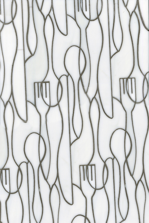 Forks Knives and Spoons, a glass waterjet mosaic shown in Moonstone, is part of the Erin Adams Collection for New Ravenna.