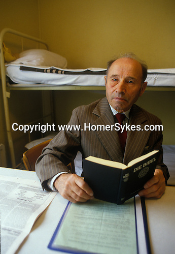Friedland refugee camp West Germany. Soviet-Germans return as refuge from the Soviet Union to freedom. Man with his bible which he was not allowed to have in the Soviet Union.