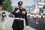 © Joel Goodman - 07973 332324 . 02/09/2013 . Bury , UK . Hundreds of fire service personnel in full dress uniform packed central Bury to listen to the service as it was relayed via loudspeaker from inside the church . The funeral of fireman Stephen Hunt at Bury Parish Church today (Tuesday 3rd September 2013) . Stephen Hunt died whilst tackling a blaze at Paul's Hair World in Manchester City Centre in July 2013 . Photo credit : Joel Goodman