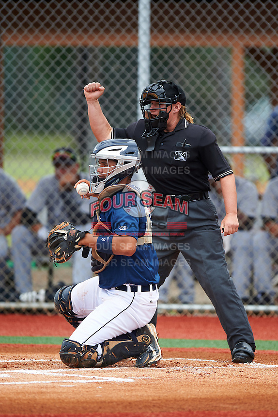 GCL Tigers East catcher Elys Escobar (22) throws the ball back to the pitcher as umpire Jennifer Pawol calls a strike during a game against the GCL Tigers West on August 4, 2016 at Tigertown in Lakeland, Florida.  GCL Tigers West defeated GCL Tigers East 7-3.  (Mike Janes/Four Seam Images)