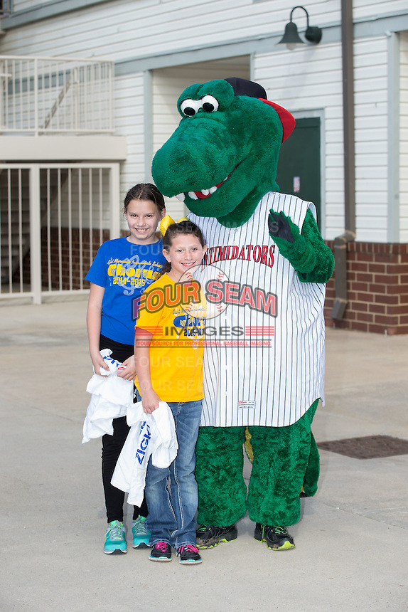Kannapolis Intimidators mascot Tim E. Gator poses for a photo with a couple of fans prior to the game against the Hickory Crawdads at Kannapolis Intimidators Stadium on April 10, 2016 in Kannapolis, North Carolina.  The Intimidators defeated the Crawdads 10-3.  (Brian Westerholt/Four Seam Images)