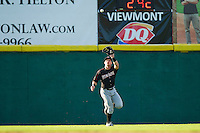 Kannapolis Intimidators left fielder Josh Richmond (13) catches a fly ball against the Hickory Crawdads at L.P. Frans Stadium on May 25, 2013 in Hickory, North Carolina.  The Crawdads defeated the Intimidators 14-3.  (Brian Westerholt/Four Seam Images)