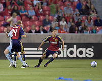 Real Salt Lake midfielder Will Johnson (8) prepares to pounce on loose ball. Real Salt Lake tied the Colorado Rockies, 1-1, at Rio Tinto Stadium on June 6, 2009.