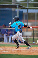 Miami Marlins Victor Mesa Jr. (10) hits a triple down the line during a Minor League Extended Spring Training game against the New York Mets on April 12, 2019 at the First Data Field Complex in St. Lucie, Florida.  (Mike Janes/Four Seam Images)