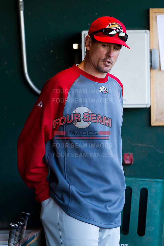 Assistant Head Coach Tony Stoecklin (00) of the Southern Illinois University- Edwardsville Cougars stands in the dugout during a game against the Missouri State Bears at Hammons Field on March 10, 2012 in Springfield, Missouri. (David Welker / Four Seam Images)