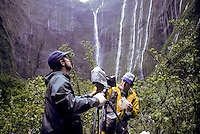 "Film-maker Paul Atkins with Dr. Steve Montgomery at """"Blue Hole"""", below Mt. Waialeale, headwaters of Wailua River, during filming of Nat. Geo. Special Strangers in Paradise."