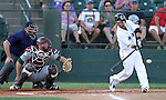 SIOUX FALLS, SD - JULY 18:  Cory Morales #5 from the Sioux Falls Canaries rips a ground ball single in front of catcher Ryan Babineau #2 fom the Gary South Shore Rail Cats in the first inning Thursday evening at the Sioux Falls Stadium.(Photo by Dave Eggen/Inertia)