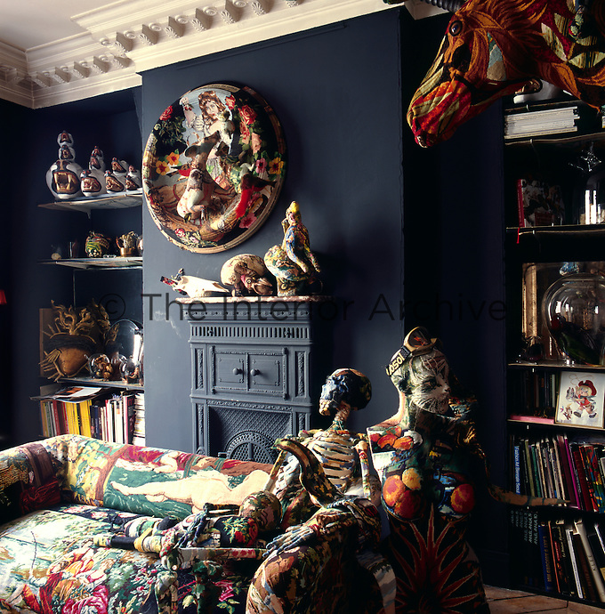 The living room in the apartment of artist Frederique Morrel. The apartment where she lives is also her studio and a reflection of her work. She works with tapestry to create animal heads, human figures and other objects
