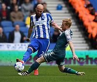 Brighton &amp; Hove Albion's Bruno Saltor (L) is tackled by   tackled by Wigan Athletic's David Perkins (R)<br /> <br /> Brighton 2 - 1 Wigan<br /> <br /> Photographer David Horton/CameraSport<br /> <br /> The EFL Sky Bet Championship - Brighton &amp; Hove Albion v Wigan Athletic - Monday 17th April 2017 - American Express Community Stadium - Brighton<br /> <br /> World Copyright &copy; 2017 CameraSport. All rights reserved. 43 Linden Ave. Countesthorpe. Leicester. England. LE8 5PG - Tel: +44 (0) 116 277 4147 - admin@camerasport.com - www.camerasport.com
