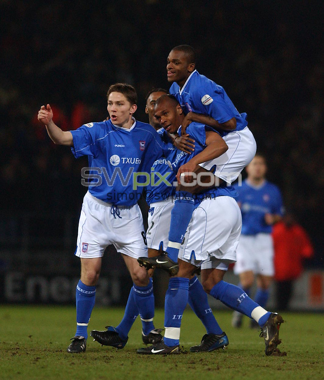 Pix: Dan Hanbury/SWpix. Soccer. Nationwide Division One. Ipswich Town v Wolverhampton Wanderers. 19/02/2003..COPYRIGHT PICTURE>>SIMON WILKINSON>>01943 - 436649>>..Ipswich Town's Marcus Bent ius mobed by teamates after opening the scoring against  Wolves during tonights division one game at Portman road..